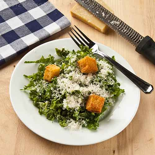 Chopped Kale Salad with Crouton Garnish on Plate with Fork