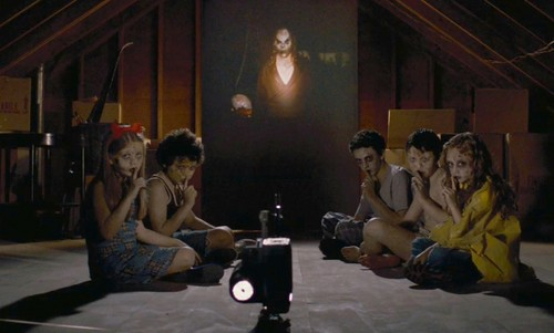 sinister-2012-002-five-pale-faced-children-in-attic-crop2