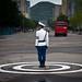 Traffic policeman, Kaesong, North Korea by Benoit Cappronnier