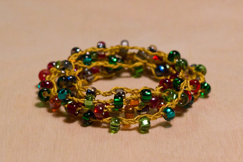 Braid with ruby, green, and black diamond beads