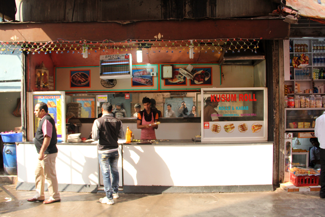 Standing and dining area at Kusum Rolls in Kolkata, India