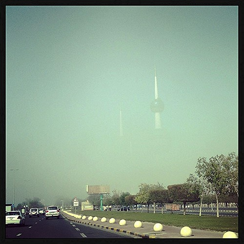 Right now, creepy fog in Kuwait. Half sunshine with half Kuwait Tower.