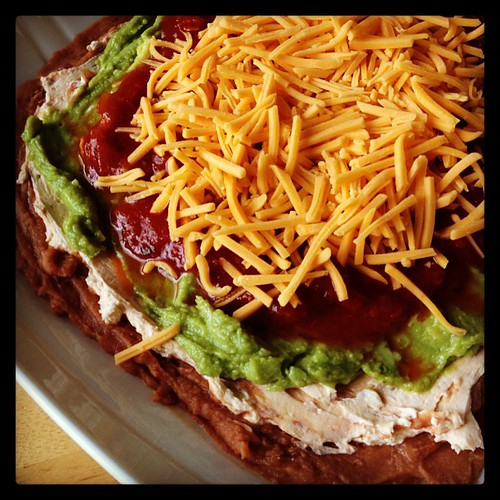 Mexican layer dip for nibbling during the Super Bowl tonight!  What will you be munching on?