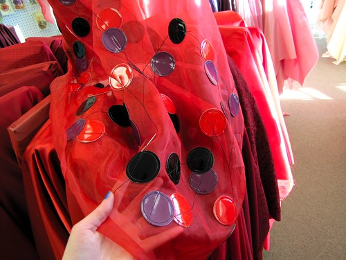 sheer red fabric with pleather circles