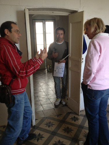 Pietro (translator / local agent), Saverio (builder) and Mary discuss options