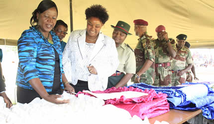 Mrs Mercy Mugove Sibanda (left) wife of ZNA commander Lt General Philip Valerio Sibanda and Mrs Senzeni Khupe admire wares exhibited by Zimbabwe Army Wives at Inkomo Barracks near Nyabira on November 27, 2012. by Pan-African News Wire File Photos