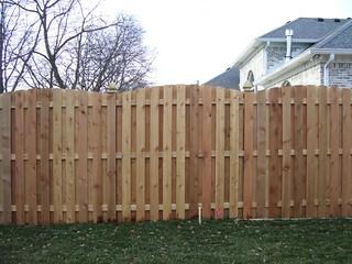 Cedar shadowbox roll top fence