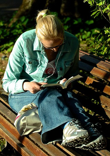 Girl reading in a intimate way