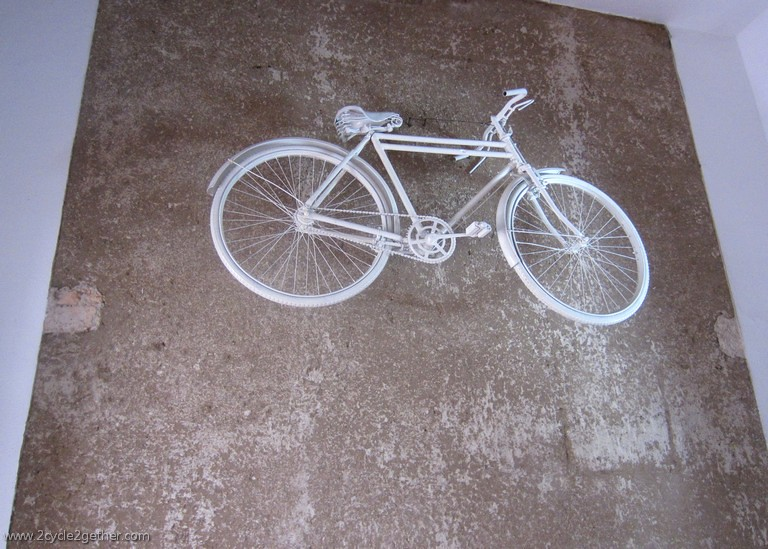 Casa Ciclista, White Bicycle Wall in Shop