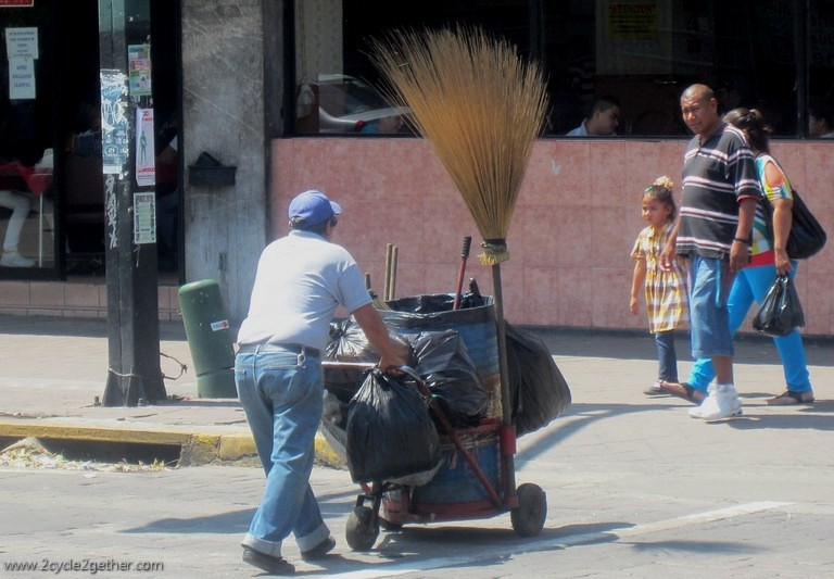 Handmade brooms are used to clean streets