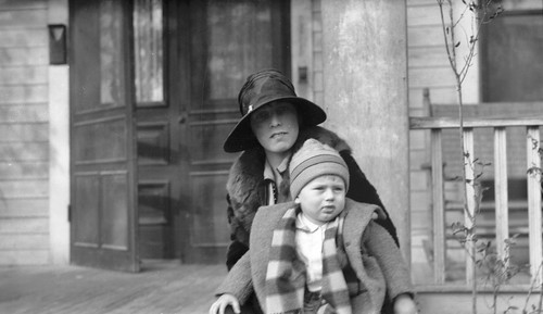 Woman and child in front porch