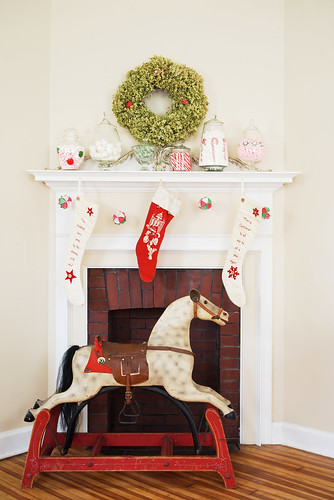Christmas fireplace display with antique pony.