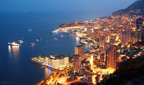 andreamoscato europe francia monaco principato city città cityscape night notte notturno view vista vivid overlook light shadow mare sea seascape mediterraneo mediterranean buildings skyscraper skyline blue yellow dark evening paesaggio panorama reflection riflesso costa litorale harbour harbor azzurra golfo boat porto