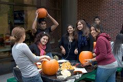 An image of students carving pumpkins during an IBSSA event