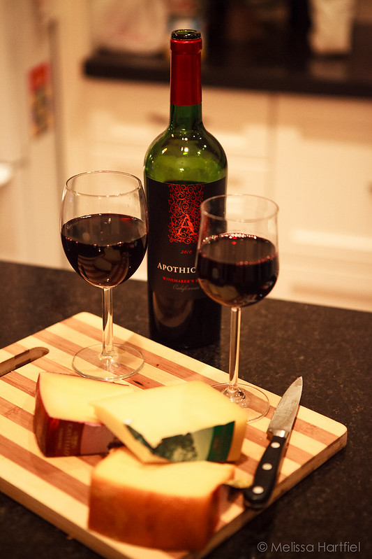 Two glasses of red wine with cheese