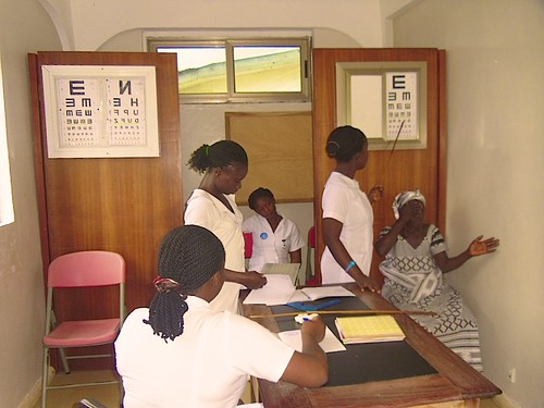 Nurses assisting an eye patent at St Michael's Hospital, Pramso, Ghana