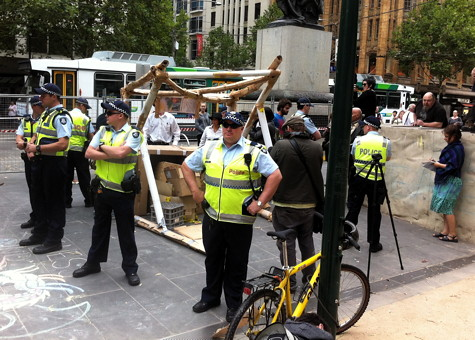 VicPol heroically protecting the public from bylaw-violating cardboard structure menace