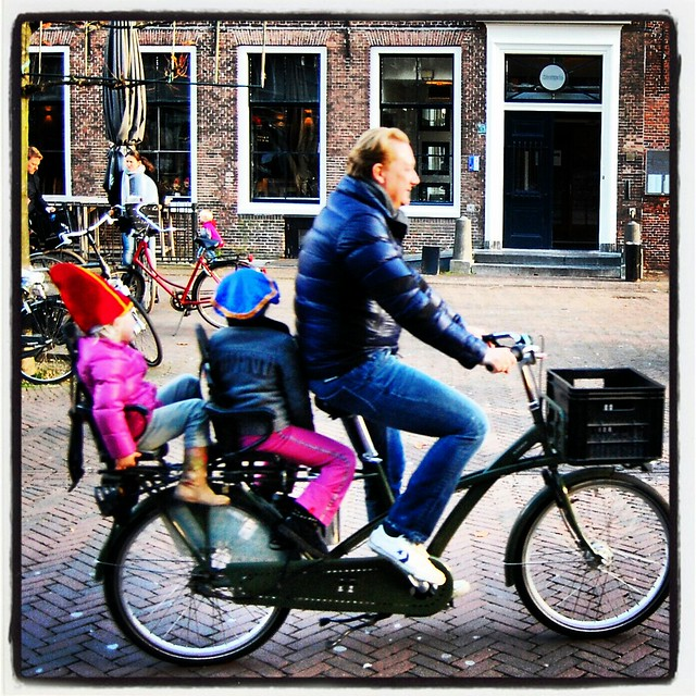 sinterklaas and piet on a bike