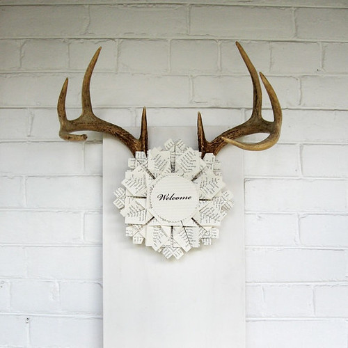 folded paper wreath with antlers as wall art