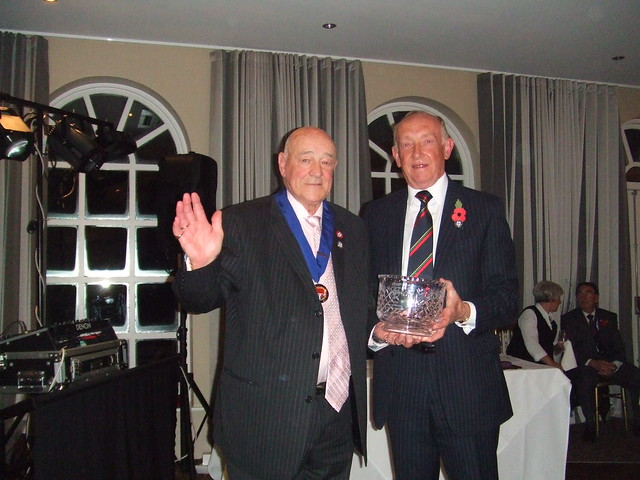 Alex McPhee, President of the Darlington Society, receives The Referees' Association Life Membership Award from Arthur Smith at the 2012 County Dinner