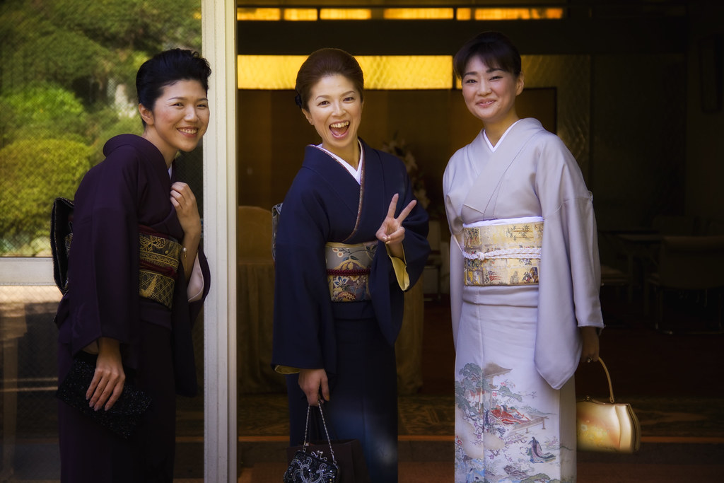 Japanese Ladies In Kimono Having Fun