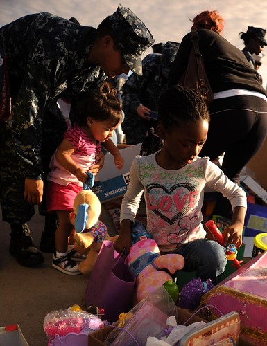 Service members and their families look through items donated by the Church of Rancho Bernardo