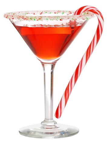 cocktail glass with dangling candy cane