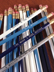 image of blue pencils with silver engraving and Arrested Development quotes