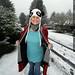 rachel, still wearing pajamas, walking home from school in the falling snow    MG 0605