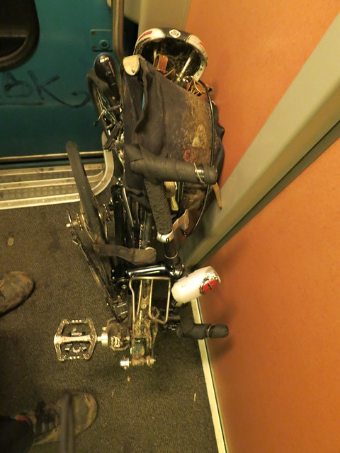 Muddy bike on the train back to gent