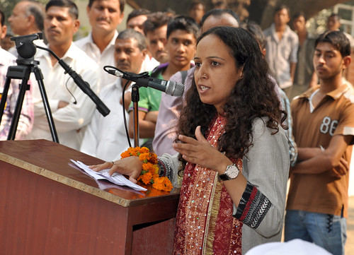 ILRI's Sapna Jarial translates speech by village council president on field day In Haryana by ILRI management and board