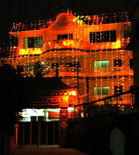 Sachen Kunga Nyingpo's memorial lights in celebration, Tashi Paljor dark in foreground, Tharlam Guesthouse, vajra gate, auspicious symbols, Sakya Lamdre, Tharlam Monastery of Tibetan Buddhism, Boudha, Kathmandu, Nepal by Wonderlane