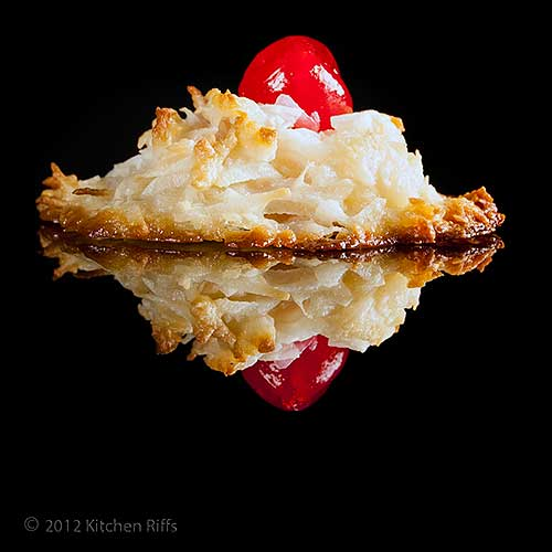Coconut Kiss with Maraschino Cherry Garnish on Black Acrylic