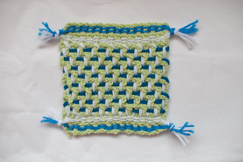 dishcloth or pot holder or coaster or something small and square