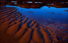 Sand, sea, rocks, & sky