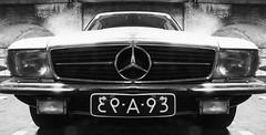 mercedes-benz(0.0), automobile(1.0), automotive exterior(1.0), wheel(1.0), vehicle(1.0), performance car(1.0), automotive design(1.0), mercedes-benz r107 and c107(1.0), grille(1.0), bumper(1.0), antique car(1.0), classic car(1.0), vintage car(1.0), land vehicle(1.0), luxury vehicle(1.0), black-and-white(1.0),
