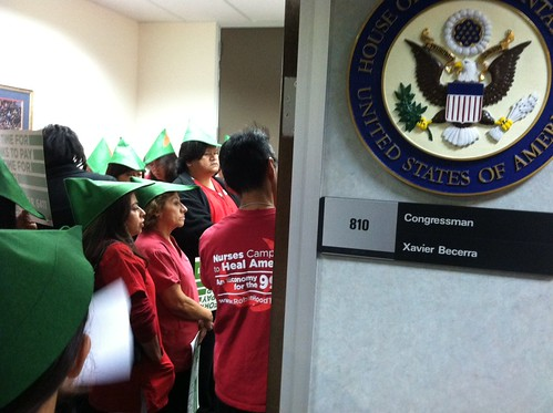 Across the coast, in Los Angeles, some four dozen nurses and activists rallied outside the district office of Rep. Xavier Becerra.