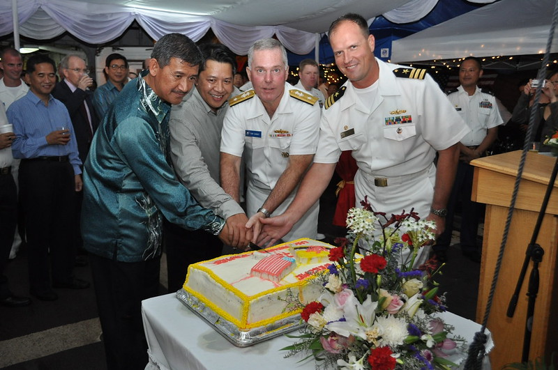 US and Royal Brunei Navy conduct cake cutting during reception onboard RJA