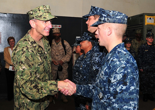Chief of Naval Operations (CNO) Adm. Jonathan Greenert greets Hull Technician 2nd Class Bryan Rollinson