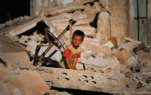 A child looking at what happened to his family house in Idlib after it was bombed by Assad warpalnes