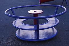 lawn game(0.0), furniture(0.0), wheel(0.0), coffee table(0.0), table(0.0), circle(1.0), blue(1.0),
