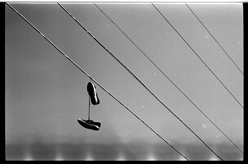Shoes on wire, Highgate Hill, Brisbane
