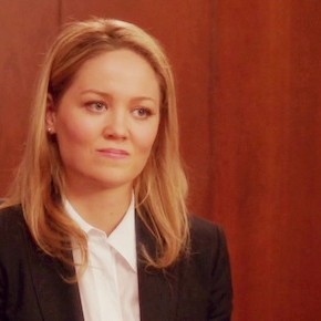 Photo of Julia Braverman-Graham (Erika Christensen) in the boardroom, looking regretful.