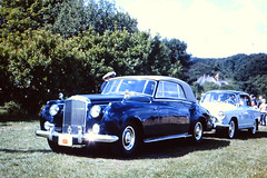 bmw 501(0.0), mid-size car(0.0), compact car(0.0), automobile(1.0), vehicle(1.0), rolls-royce silver cloud(1.0), antique car(1.0), sedan(1.0), classic car(1.0), vintage car(1.0), land vehicle(1.0), luxury vehicle(1.0), motor vehicle(1.0),