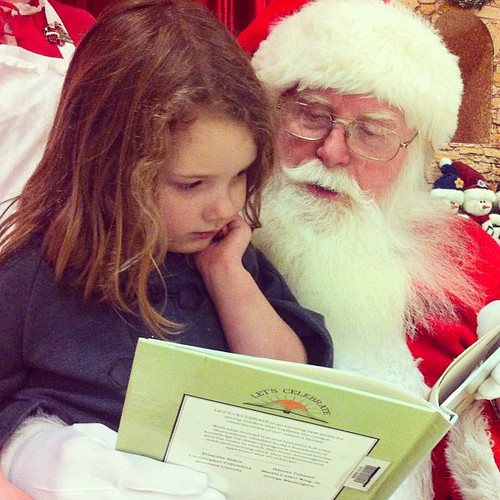 You guys, my heart melted. She took Santa a book and he read it with her. #holidaybliss