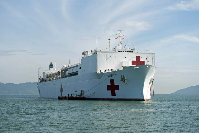 DA NANG, Vietnam (July 28, 2016) Hospital ship USNS Mercy (T-AH 19) sits anchored off the coast of Da Nang, during its third mission stop of Pacific Partnership 2016. Mercy is joined in Da Nang by JS Shimokita (LST-4002) and Vietnam People's Navy ship Khánh Hóa for Pacific Partnership. Partner nations are working side-by-side with local organizations to conduct cooperative health engagements, community relation events and subject matter expert exchanges to better prepare for natural disaster or crisis. (U.S. Navy photo by Mass Communication Specialist 1st Class Elizabeth Merriam/Released)