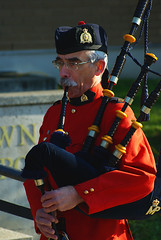 person, bagpipes,