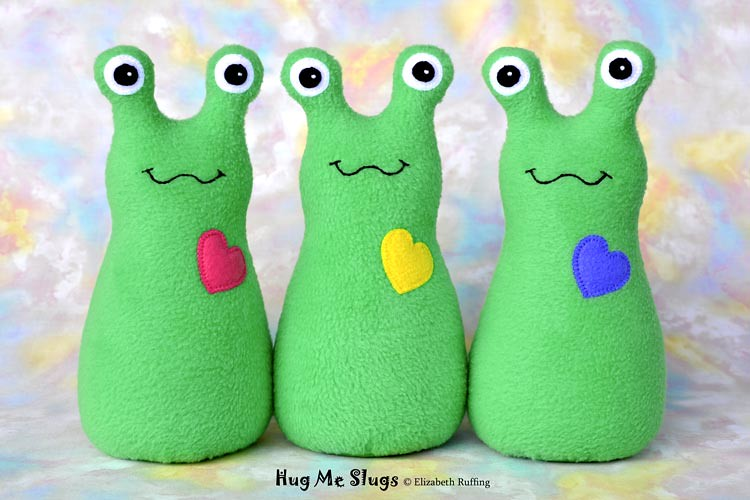 Slugterra and bright medium green fleece Hug Me Slugs, original stuffed animal art toy by Elizabeth Ruffing