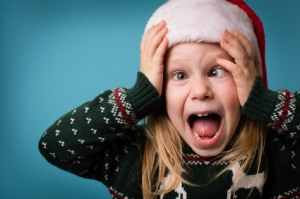 image of screaming little girl in a Santa hat