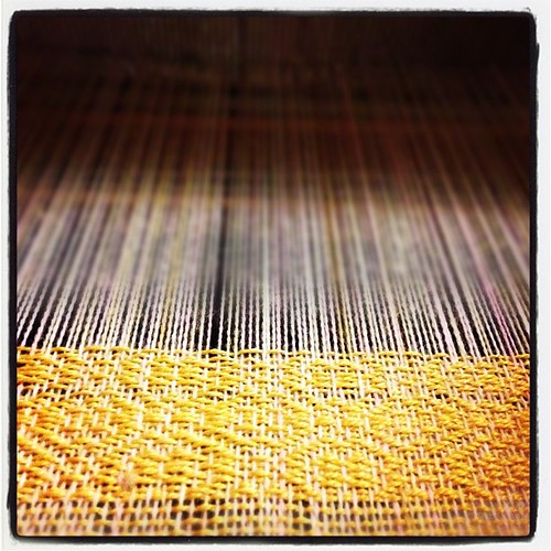 A four shaft twill with bamboo yarn.  This will be soft!  #weaving
